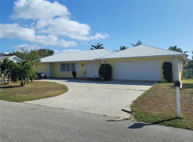 Photo of 1161 NE Fairview Ln, Riviera Beach, FL 33404 (MLS # F10271418)