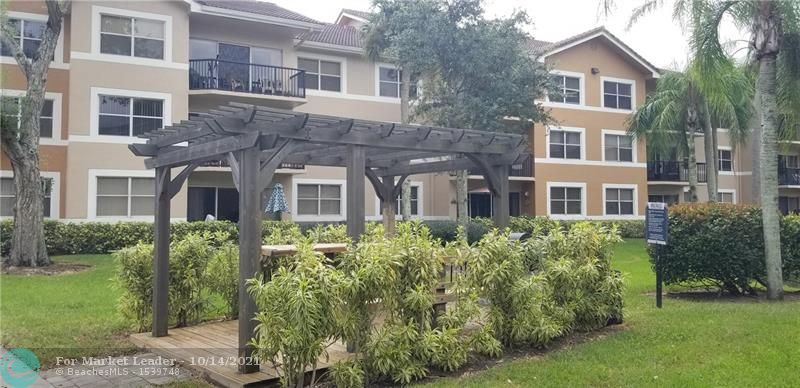 Photo of 9055 Wiles Rd #304, Coral Springs, FL 33067 (MLS # F10304422)