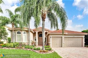 Photo of 12055 NW 50th Dr, Coral Springs, FL 33076 (MLS # F10184424)