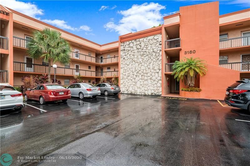 Photo of 3160 Holiday Springs Blvd #7-305, Margate, FL 33063 (MLS # F10232426)