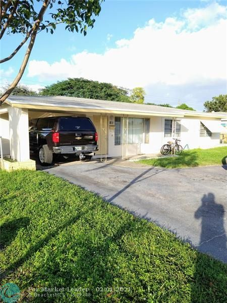 Photo of 811 NW 39th St, Oakland Park, FL 33309 (MLS # F10259430)