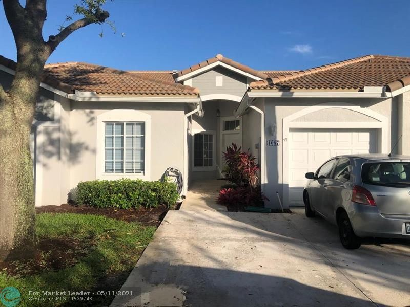 Photo of 1087 SW 42nd Way, Deerfield Beach, FL 33442 (MLS # F10283431)