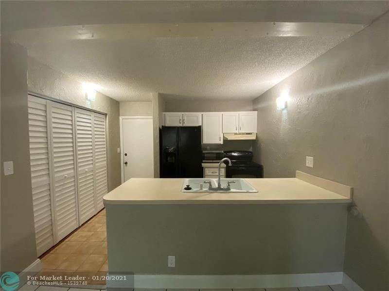 Photo of 2771 Riverside Dr #111-A, Coral Springs, FL 33065 (MLS # F10267433)