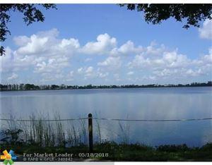 Photo of 110 Lake Emerald Dr #102, Oakland Park, FL 33309 (MLS # F10122437)