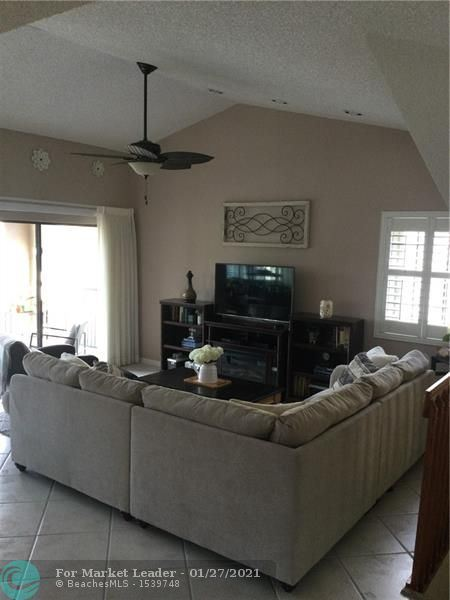 Photo of 1667 Cypress Pointe Dr #3B, Coral Springs, FL 33071 (MLS # F10268437)