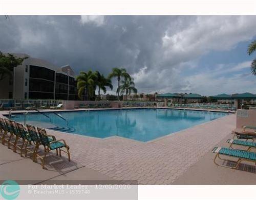 Photo of 7553 Fairfax Dr #213, Tamarac, FL 33321 (MLS # F10261442)