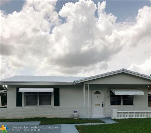Photo of 4717 NW 47th Ter, Tamarac, FL 33319 (MLS # F10206443)