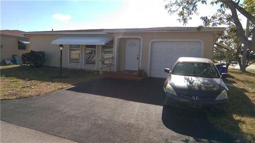 Photo of 4921 NW 14th Ave, Deerfield Beach, FL 33064 (MLS # F10279444)