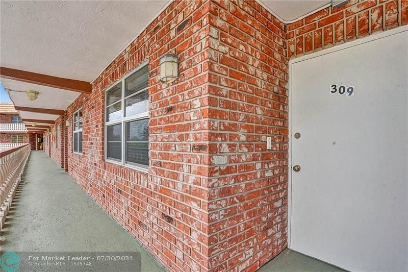 Photo of 801 NE 18th Ct #309, Fort Lauderdale, FL 33305 (MLS # F10294444)
