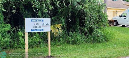 Photo of 320 SW Enon St, Port Saint Lucie, FL 34953 (MLS # F10295445)