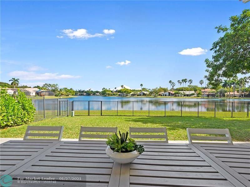 Photo of 2098 Cove Ln, Weston, FL 33326 (MLS # F10268445)