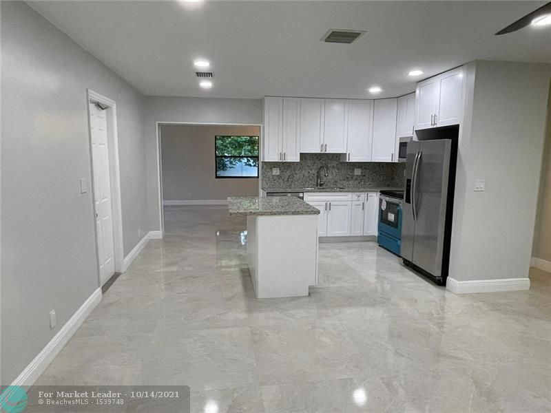 Photo of 1810 SW 65th Ave, North Lauderdale, FL 33068 (MLS # F10304445)