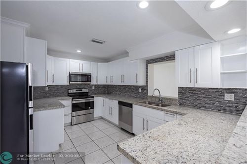 Photo of 1660 NW 43rd St, Oakland Park, FL 33309 (MLS # F10217446)