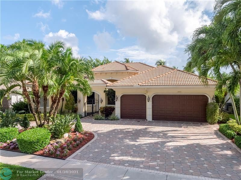 Photo of 10887 Blue Palm St, Plantation, FL 33324 (MLS # F10268447)