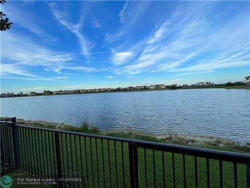 Photo of 8446 Lake Majesty Ln #8446, Parkland, FL 33076 (MLS # F10293451)