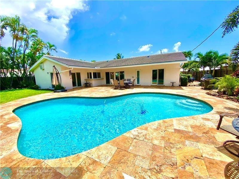 Photo of 5131 NE 26th Ave, Fort Lauderdale, FL 33308 (MLS # F10292454)