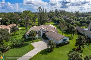 Photo of 6882 NW 65th Ter, Parkland, FL 33067 (MLS # F10202456)