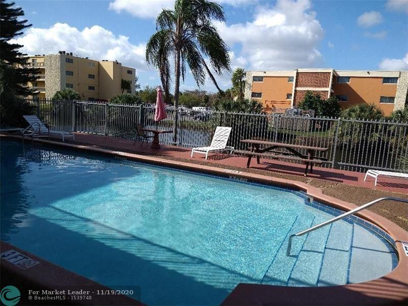 Photo of 4040 NW 19th St #207, Lauderhill, FL 33313 (MLS # F10259458)