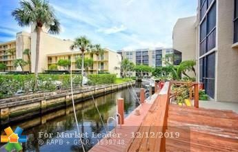 Photo of 16 Royal Palm Way #205, Boca Raton, FL 33432 (MLS # F10190460)