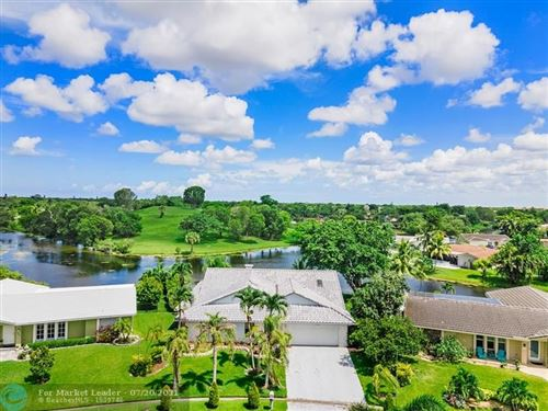 Photo of 12064 NW 30th St, Coral Springs, FL 33065 (MLS # F10293461)