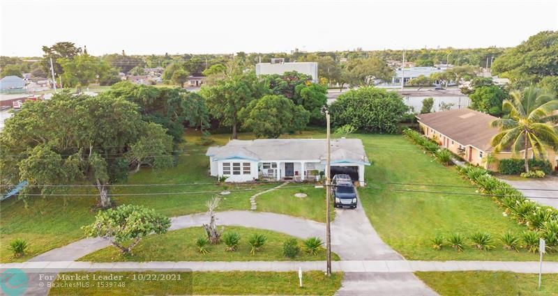 Photo of 2600 NW 20th St, Fort Lauderdale, FL 33311 (MLS # F10305464)