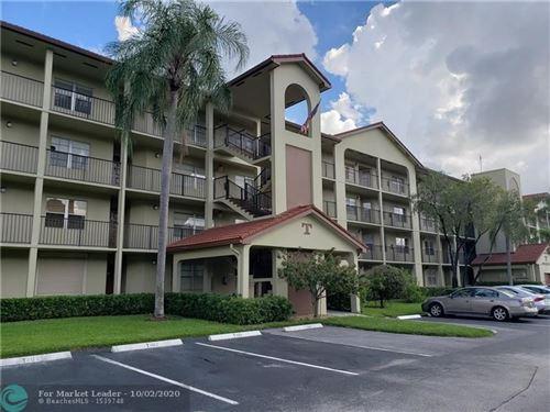 Photo of 13001 SW 15th Ct #306, Pembroke Pines, FL 33027 (MLS # F10251468)
