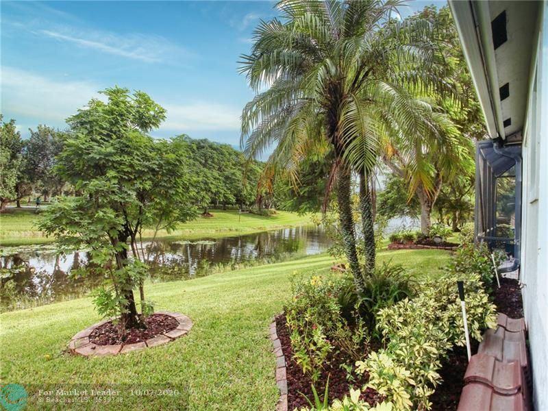 Photo of 10755 NW 64th Ct, Parkland, FL 33076 (MLS # F10252469)