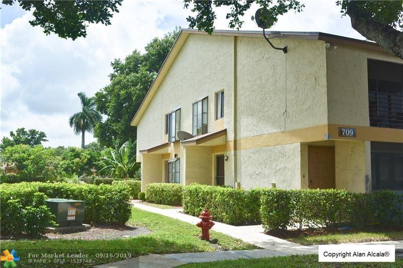 Photo of 709 Gardens Dr #102, Pompano Beach, FL 33069 (MLS # F10193479)