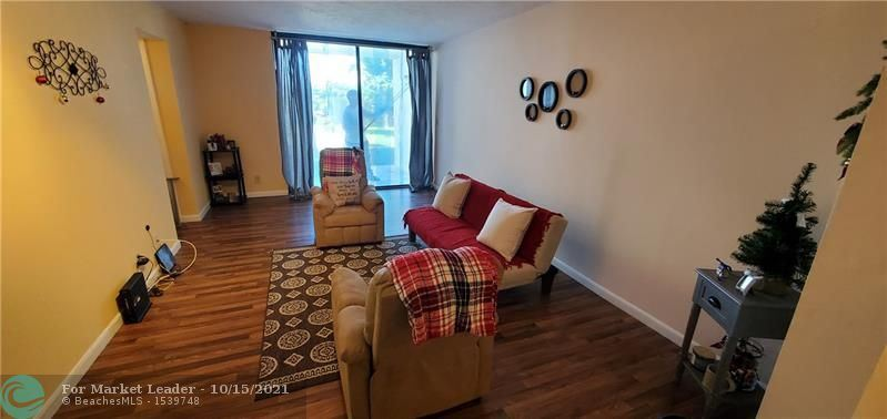 Photo of 211 Lake Pointe Dr #108, Oakland Park, FL 33309 (MLS # F10304479)