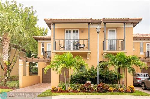 Photo of 6941 Julia Gardens Dr, Coconut Creek, FL 33073 (MLS # F10305483)