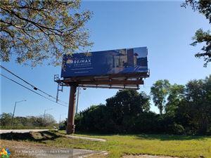 Photo of 11200 Griffin Rd, Davie, FL 33328 (MLS # F10171486)