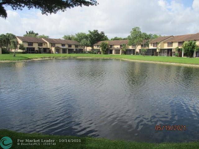Photo of 3962 Cocoplum Cir #E, Coconut Creek, FL 33063 (MLS # F10304486)