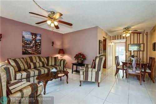 Photo of 13350 SW 1st St #207-P, Pembroke Pines, FL 33027 (MLS # F10265491)