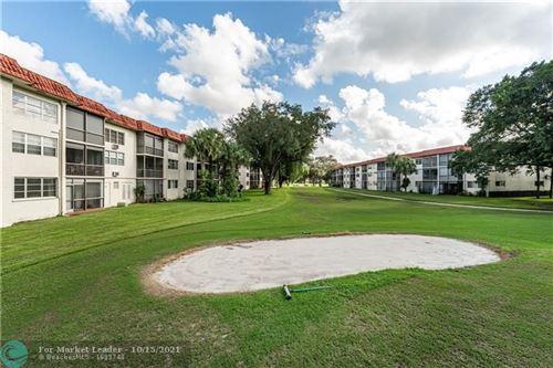 Photo of 8901 S Hollybrook Blvd #104, Pembroke Pines, FL 33025 (MLS # F10304500)