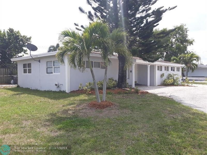 Photo of 650 NW 39th St, Oakland Park, FL 33309 (MLS # F10294508)