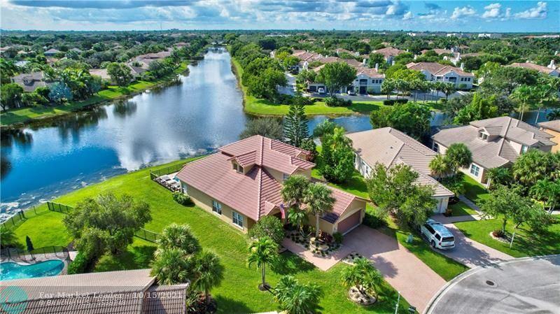 Photo of 11134 NW 65th Ct, Parkland, FL 33076 (MLS # F10304513)