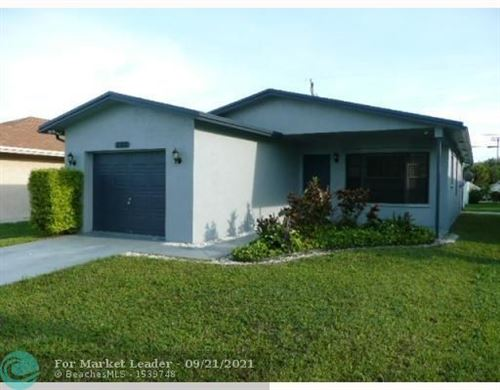 Photo of 2312 Raleigh St, Hollywood, FL 33020 (MLS # F10301516)