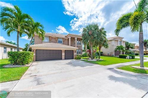 Photo of 2237 Ridgewood Cir, Royal Palm Beach, FL 33411 (MLS # F10304516)