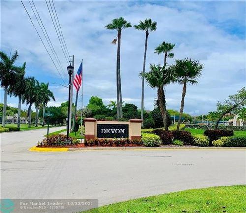 Photo of 7488 N Devon Dr #110, Tamarac, FL 33321 (MLS # F10305518)