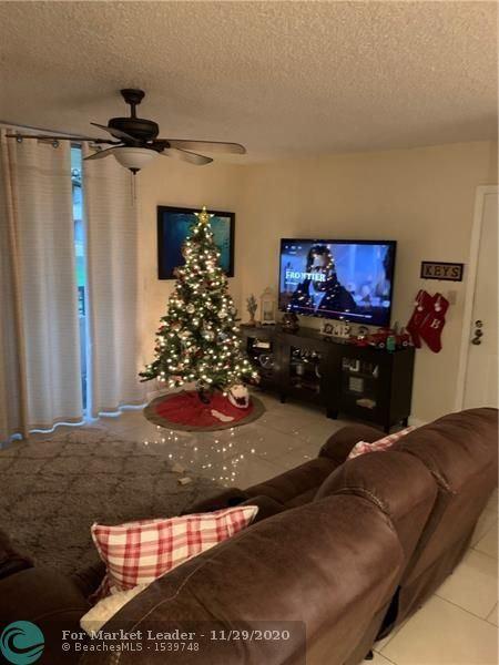 Photo of 851 Lyons Rd #22107, Coconut Creek, FL 33063 (MLS # F10260523)