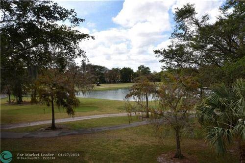 Photo of 6701 N University Dr #310, Tamarac, FL 33321 (MLS # F10268525)