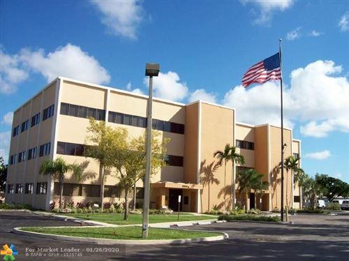 Photo of 7777 DAVIE RD EXT #201A, Davie, FL 33024 (MLS # F10213526)
