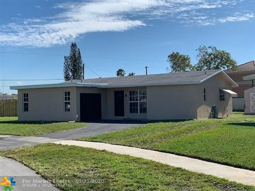 Photo of 9840 NW 24th Pl, Sunrise, FL 33322 (MLS # F10185528)