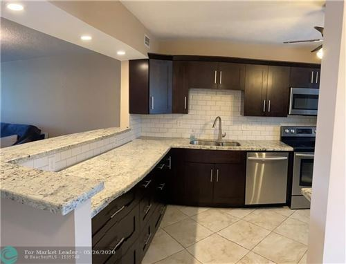 Photo of 2850 Forest Hills Blvd #203, Coral Springs, FL 33065 (MLS # F10229529)