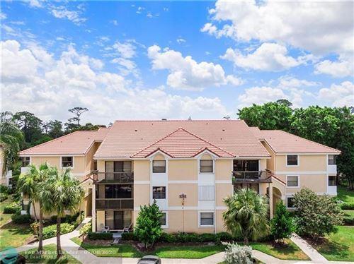 Photo of 5761 Riverside Dr #104B4, Coral Springs, FL 33067 (MLS # F10237530)