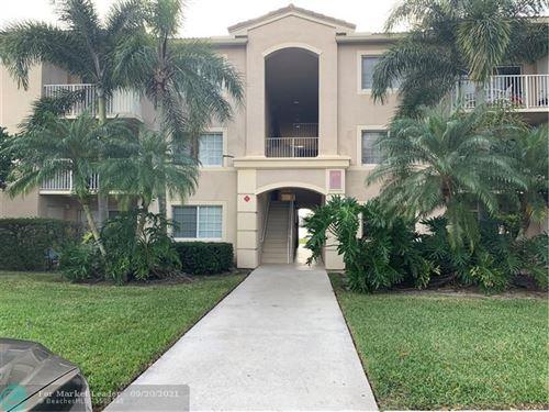 Photo of 5045 Wiles Rd #102, Coconut Creek, FL 33073 (MLS # F10301530)