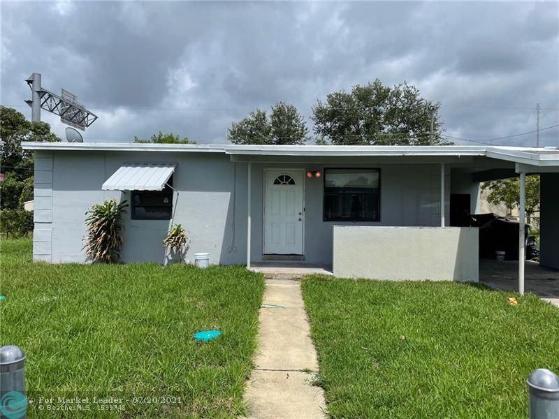 Photo of 1854 Lauderdale Manor Dr, Fort Lauderdale, FL 33311 (MLS # F10293530)