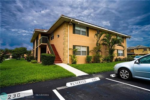 Photo of 10485 NW 7th St #202, Pembroke Pines, FL 33026 (MLS # F10289538)