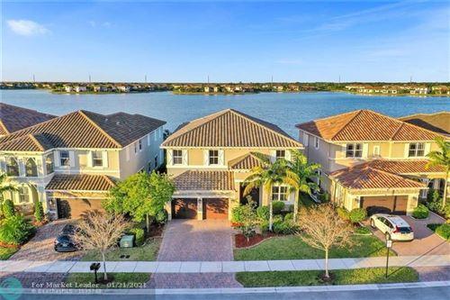 Photo of 9781 Blue Isle Bay, Parkland, FL 33076 (MLS # F10267540)