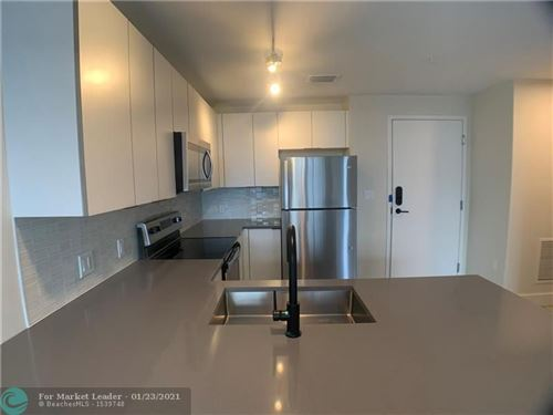 Photo of 121 N Compass Way #215, Dania Beach, FL 33004 (MLS # F10265545)